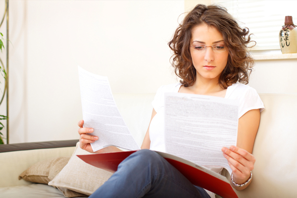 Woman reading proposed tax statement